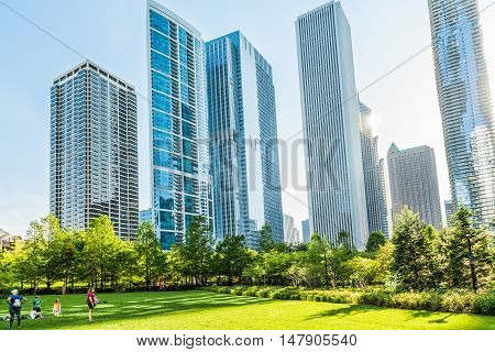 Chicago, USA - May 30, 2016: Downtown residential skyscrapers in Lake Shore East Park with people.