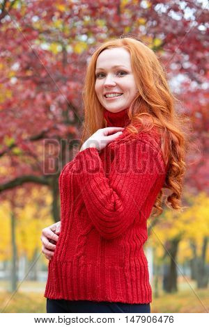 girl portrait in autumn season, background from red and yellow leaves