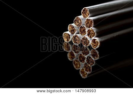 Close-up of Tobacco Cigarettes Background. Cigarettes pile,