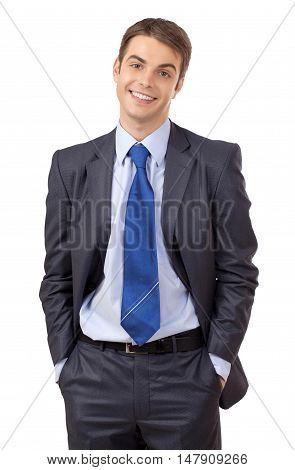 Happy Young Businessman with Hands in Pockets