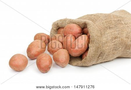Red Potato Tubers In A Sack Isolated On White