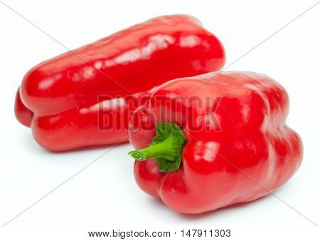 Pair fresh red bell pepper isolated on white background close-up.