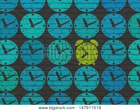 Timeline concept: rows of Painted blue clock icons around green alarm clock icon on Black Brick wall background