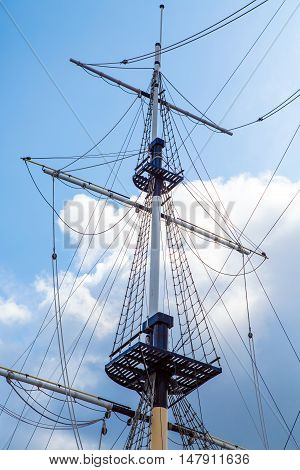 Ship's mast sailboat. The romance of travel and far wandering. Background marine themes. Ocean transport ship under sail.