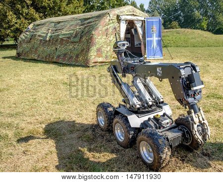 Ferrara Italy 16 September 2016 - a bomb disposal robot unit used by the Army to defuse bombs and a military green curtain during an exposition of the Italian Air Force Army