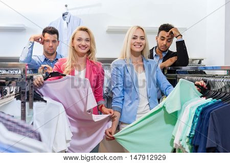 Young People Shopping, Fashion Shop Happy Smiling Woman Choosing Clothes, Tired Man Bored Customers In Retail Store