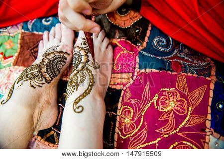 Picture of human hand being decorated with henna Tattoo. mehendi hand