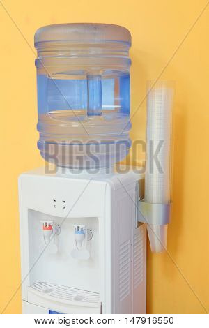 The image of a water cooler in an office