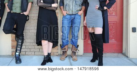 Grunge fashion models at a photoshoot outside.