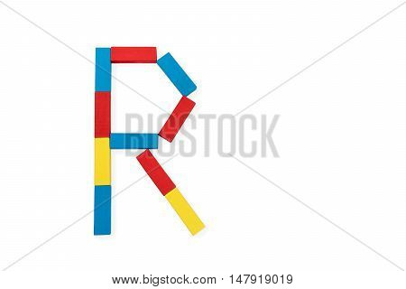 Capital letter R made up of different color wooden rectangular blocks isolated on a white background