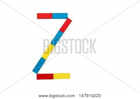Capital letter Z made up of different color wooden rectangular blocks isolated on a white background