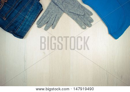 Vintage Photo, Womanly Clothes On Wooden Background, Clothing For Autumn Or Winter