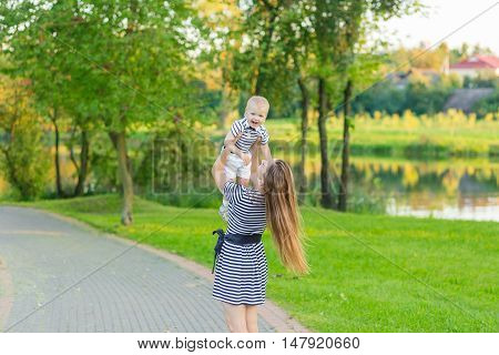 Portrait Of Mother And Son On The Nature