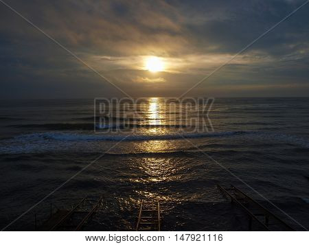 Dawn in the Crimea in the winter - the view from the boathouse on the shore of the Black Sea