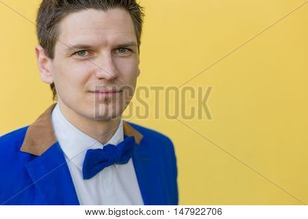 Portrait Of A Man In A Blue Jacket On A Yellow Background