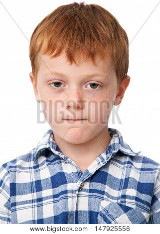 Little serious boy in checkered shirt isolated on white background