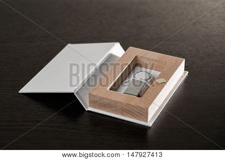 Packaging for USB drives. Handmade box. Wooden boxes on dark background.