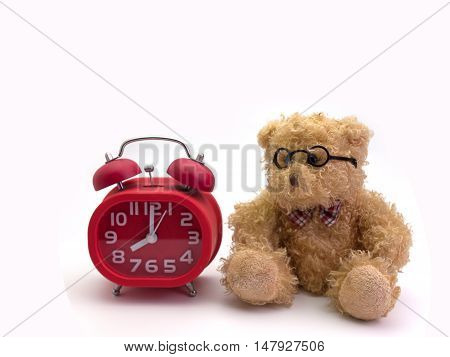 teddy bear and alarm clock Concept about loneliness and waiting for someone.