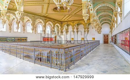 TUNIS TUNISIA - SEPTEMBER 2 2015: The ceiling of Carthage Room of Bardo National Museum decorated with colored and gilt wooden carvings on September 2 in Tunis.