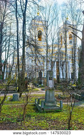 The view on the Holy Trinity Cathedral through the cemetery garden Alexander Nevsky Monastery Saint Petersburg Russia.