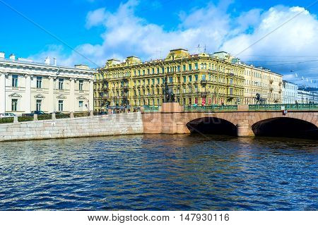 SAINT PETERSBURG RUSSIA - APRIL 25 2015: The Anichkov Bridge is one of the most beautiful sites in city connecting banks of Fontanka River on April 25 in Saint Petersburg.