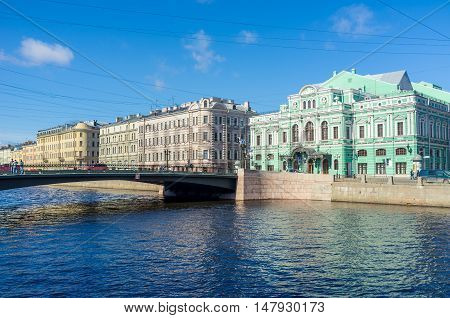 SAINT PETERSBURG RUSSIA - APRIL 25 2015: The view on the Tovstonogov Bolshoi Drama Theater (Great Dramatic) and the Leshtukov Bridge across Fontanka River on April 25 in Saint Petersburg.