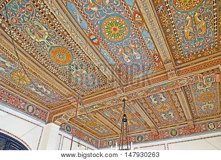 TAORMINA ITALY - OCTOBER 1 2012: The ceiling of Taormina-Giardini Railway Station decorated with painted colorful traditional patterns on wooden panels on October 1 in Taormina.