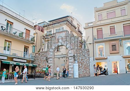 TAORMINA ITALY - OCTOBER 1 2012: The Porta Messina (Gate) is the part of preserved ancient fortification nowadays located among the boutiques souvenir stalls and cafes on October 1 in Taormina.