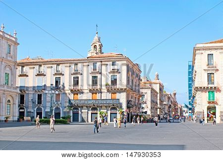 CATANIA ITALY - OCTOBER 10 2012: The University Square boasts perfect architectural ensemble making it one of the most picturesque in city on October 10 in Catania.
