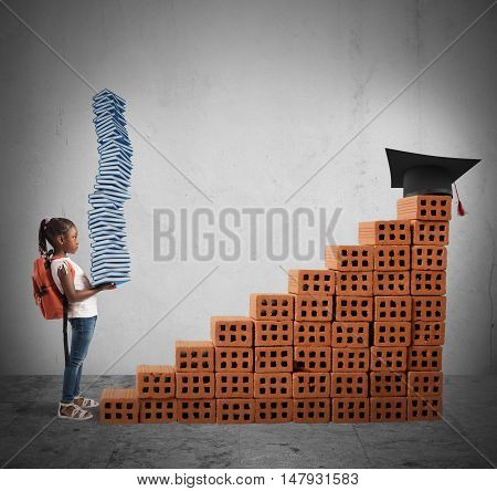 Child with backpack and study books climbs a bricks scale