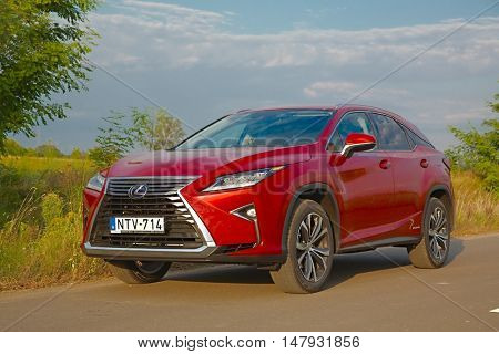 BUDAPEST, HUNGARY - september 08, 2016. Lexus RX450h four wheel drive SUV on the road. This vehicle features hybrid drive