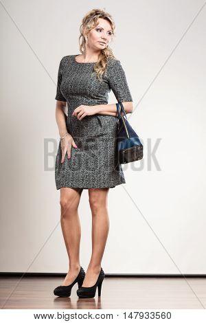 Mature Business Woman Holds Handbag