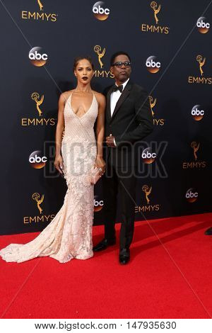 LOS ANGELES - SEP 18:  Guest, Chris Rock at the 2016 Primetime Emmy Awards - Arrivals at the Microsoft Theater on September 18, 2016 in Los Angeles, CA