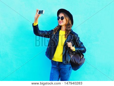 Fashion Pretty Cool Young Girl Taking Photo Makes Self Portrait On Smartphone Wearing A Black Rock S