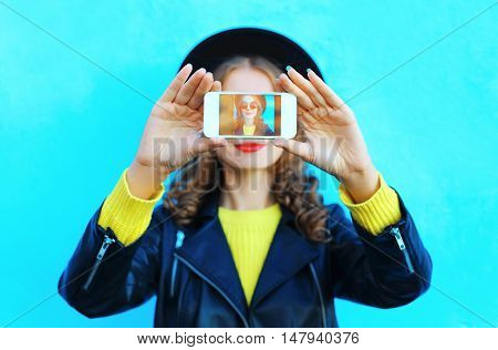 Fashion Pretty Woman Taking Photo Self Portrait On Smartphone Over Blue Colorful Background