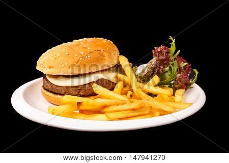 Cheeseburger With French Fries, Lettuce And Ketchup Lying On A S