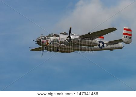 NEW WINDSOR NY - SEPTEMBER 03 2016: Panchito is a North American B-25 Mitchell from the Word War II Era flying over Stewart Airport at the New York Airshow