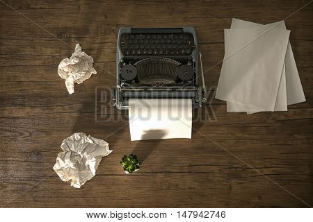 Retro typewriter with sheet of paper on wooden background