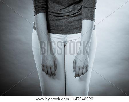 Desperation and resignation concept. Part body slim female with resigned pose. Body language sadness and no hope for tomorrow.