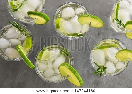 Cold fresh cocktails with lime on light background