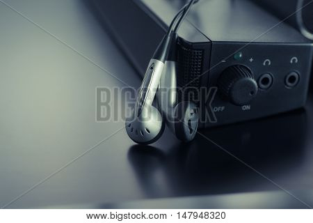 earpiece with speaker on modern dark background .
