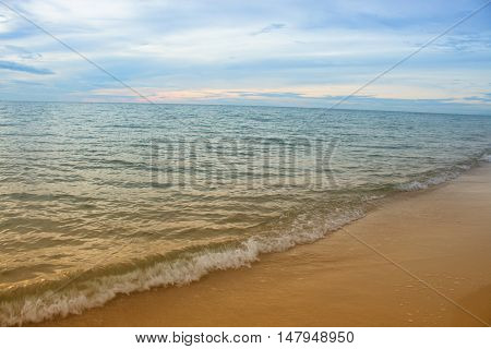Sea water and beach and sky. Cold Warm Filter look Colorful. with lighting reflect in the sunrise morning.
