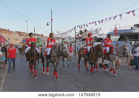 SAINT TROPEZ FRANCE - JULY 12: Saint Tropez Polo Team on JULY 12 2013. Saint Tropez Polo Team parade at horses during International Polo Cup in Saint Tropez France.