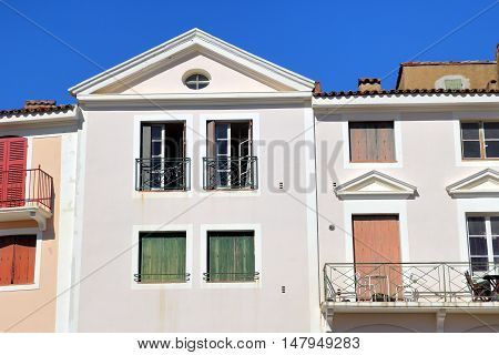 Classic French Provencal architecture with shutters and balcony
