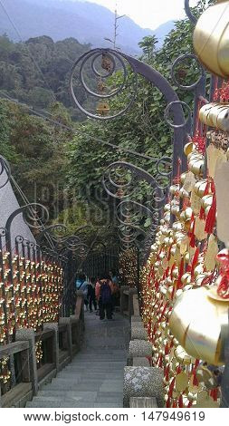 Staircase of golden prayer lanterns at the sun moon lake temple in Taiwan.