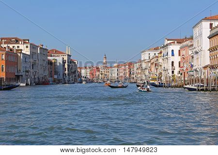 VENICE ITALY - JULY 08: Grand Canal in Venice on JULY 08 2013. Famous Grand Canal near Rialto Bridge in Venice Italy.