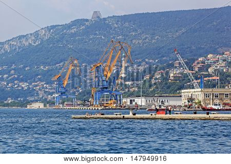 TRIESTE ITALY - JULY 15: Cranes at Port of Trieste on JULY 15 2013. Docks and Cranes at Harbour in Trieste Italy.