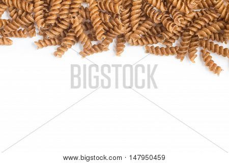 Wholemeal Fusilli Frame. Integral Pasta isolated in white background