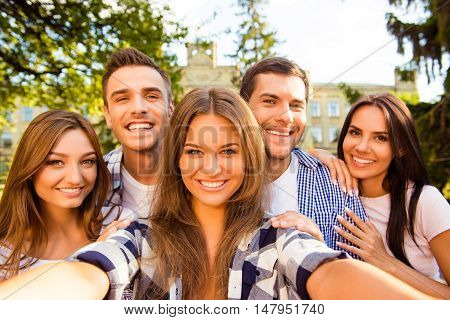Five Cheerful Best Friends Having Fun And Making Selfie Photo While Looking At Camera