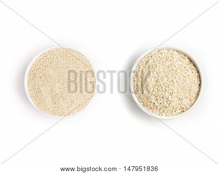 Quinoa seeds and Flakes into a bowl isolated in white background. Super Food.